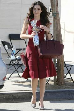 Emmy Rossum wearing Bally Sommet Bag, Alaia Animal Print Calf Hair Pumps and Snob Essentials Croco-Embossed Pouch in Wine