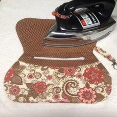 Acompanhe o passo à passo de como fazer uma carteira clutch de tecido ou carteira envelope.