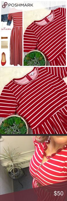 """•Lularoe• AMELIA Red & White Candy Strip Dress L How ADORABLE is this dress!!!! Perfect for the upcoming holiday season!! LuLaRoe Amelia Dress with back zipper (can be worn reversed as well see pics!!) ... true candy apple red & white stripes. Pockets. Crazy comfortable. This is true to size. Women's Large. In excellent condition from a smoke free home!!   Measurements: Armpit to armpit: 19"""" Waist: 15"""" unstretched Shoulder to bottom: 41"""" front - 43"""" back  Across bottom: 35"""" LuLaRoe Dresses"""