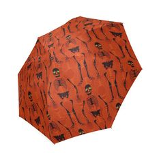 Black glowing-eyed skeletons on a bright orange background. Orange Background, Skeletons, Halloween Themes, Umbrellas, I Shop, Model, Black, Style, Swag