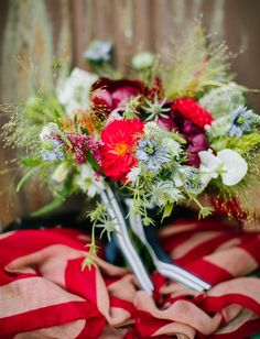 Red white and blue wedding bouquet with firework-inspired foliage