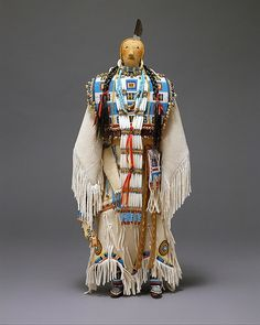Female Doll Joyce Growing Thunder Fogarty  (American, born 1950) Date: 2000 Geography: United States, Montana Culture: Assiniboine or Sioux Medium: Cotton, glass, leather, metal, hair, feather, ribbon, shell Dimensions: H. 19 1/2 x W. 9 in. (49.5 x 22.9 cm) Classification: Textiles-Sculpture Credit Line: Ralph T. Coe Collection,