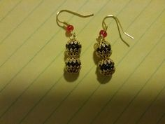 Small dangle earrings made with black acrylic beads & gold plated bead caps. Stainless steel hypo-allergenic french hooks or standard gold plated brass french hooks.