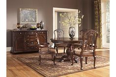 "The North Shore Dining Room Upholstered Arm Chair from Ashley Furniture HomeStore (AFHS.com). A deep rich stained finish and exquisite details come together to create the ultimate in grand traditional design with the elegance of the ""North Shore"" dining room collection."