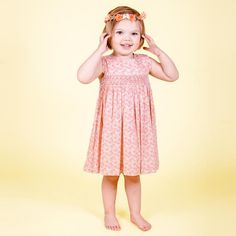 This sweet sleeveless ditzy pink frock is utterly charming in shades of peach blossom and sunny apricot. It features a hand smocked waistband and matching bloomers. Shades Of Peach, Peach Blossoms, Frocks, Smocking, Sunnies, Summer Dresses, Pink, Fashion, Moda