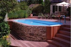"Above ground pool (much cheaper) made to look ""built in."""