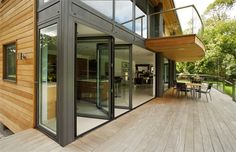 These aluminium folding doors stack internally in-line with the architects design for an uninterrupted deck when the doors are in use during the summer months. Product used: Sunparadise Supertherm80. Sunparadise folding door products have the versatility of internal or external stacking options as well as top hung or floor supported to best suit the build.