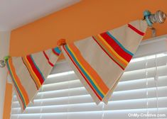 No-sew Window Treatment using pillow covers and napkin rings.