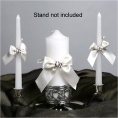"Unity Candle Set - With This Ring - White - WeddingDepot.com - 255-WW-K463CD With this collection, you can now have a unity candle set for all your guests to see as you have your candle-lighting during your ceremony. Each set includes one pillar candle (9""x3"") and two taper candles (10""). All are accented with ribbon and rings."
