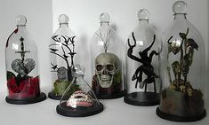 Create inexpensive bell or cloche jars with recycled soda bottles for a creeepy Halloween display. Tutorial from Seeing Things