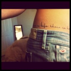 Quote tattoo on hip