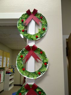 Paint wreath, add green tissue paper and red pom poms