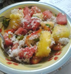 Chopped up watermelon, pineapple, spring onions, tomatoes, papaya, with shredded coconut pulp leftover from making coconut milk. Yum
