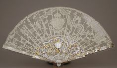 Fan Point d'Angleterre bobbin lace; mount of mother-of-pearl with gold and diamonds - This precious fan and its protective case may have been a gift to King Ferdinand VI of Spain (1713–1759) and his wife, Maria Magdalena Barbara, Infanta of Portugal (1711–1758), whose conjoined coat of arms is worked into the lace and its mount.