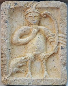 Silvanus - Votive relief dedicated to Roman God Silvanus. -- The double-horned god Silvanus (with iconography of Pan) holds a panpipe or syrinx in his right hand and a bow in his left. Over his elbow (ancon) he has draped most certainly a shawl or cloth. A quadruped seems to bit him in his thigh. Silvanus, horned god (Pan) [2nd-3rd century AD] - Split, Archaeological Museum