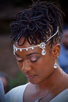This is a beautiful loc petal hair style and head accessories great for a wedding or just bring the princess out in you.