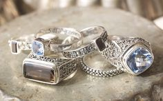 pretty scrollwork, Smoky Quartz, Blue Quartz, Silver Rings all by Sara Blaine for Willow House ...  priced at $98 to $130 .