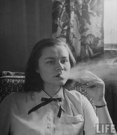 Physical education teacher Jane Shoemaker smoking in the teacher's lounge.Location: Allentown, PA, USDate taken: 1948Photographer: Nina Leen