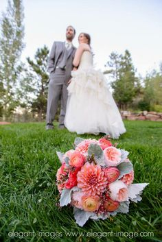 One of our favorite photos featuring the bridal bouquet with Erin & Nate in the background.