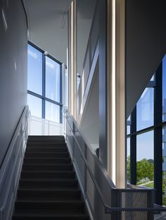 Chesapeake Building 14 by Elliott + Associates Architects.  The northwest stair acts as a glass vitrine for people.  Vertical column lights make the stair into a glowing lantern at night.  The 5th floor landing provides an aerial view of the adjacent campus.