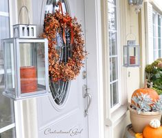 Autumn berry wreath and hanging lanterns on porch (could switch out colors for other holidays as well)