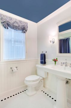 Design A Bathroom Thatu0027s Out Of The Ordinary With White Walls And A Blue  Ceiling.