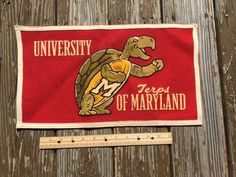 Pin by Phillip Corbiere on Vintage College Banners Felt Banner, University Of Maryland, College Banners, Wool Felt, Flag, Vintage Logos, Lettering, Bradford, College Football