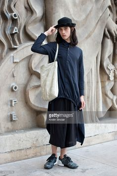 Model Louis Kurihara wears Limi Feu with Y's bag, Tiger trainers and Vintage hat on day 5 of Paris Fashion Week Menswear Spring/Summer 2016 on June 28, 2015 in Paris, France.