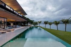 Jacobsen Arquitetura design an open space house with transparent façades on an island in Angra dos Reis, Brazil - CAANdesign | Architecture and home design blog