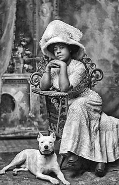 African American woman in the 1890s, posing with her faithful bulldog.