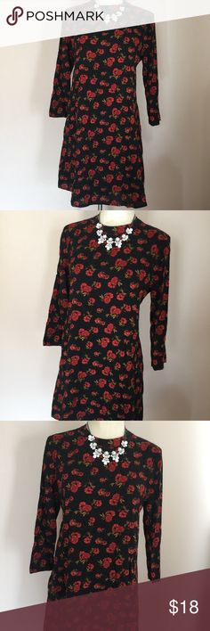 """Forever 21 Red Rose Floral Print Boho Dress NWT L New with tags, black dress with red roses from Forever 21. Dress has an a-line fit with long sleeves. The sleeves are fitted, but the front of he dress flares out. Looks great with tights or high boots. Closes in the back with buttons. Tagged a size large and measures: 40"""" across bust and 34"""" from shoulder to hem. Forever 21 Dresses Mini"""