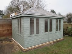 Ex-Demo Cley Summerhouse with Grey Slate Effect Tiles  This Ex Demo Cley Summerhouse in Chinnor, Oxfordshire is a traditional looking garden building. Built for our customer's children to be used as a play room. Full Details:- https://www.cranegardenbuildings.co.uk/installed-buildings-oxfordshire/summerhouse-in-chinnor