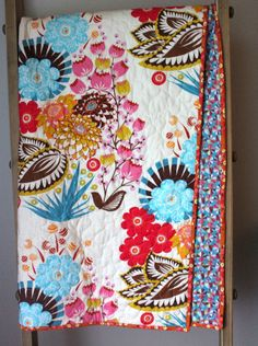 Boho Toddler Quilt  This bohemian baby quilt is made using a beautiful large scale floral pattern from Anna Maria Horner. It is bold and unique and