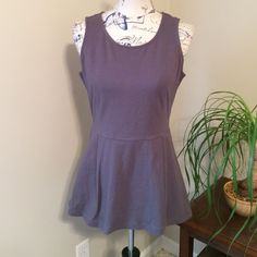 Peplum Gray Top Never worn. Very cute and basic peplum top. Soft material. Wish this was more my style. Thought I would wear it one day but it's been sitting on my closet for over a year with the tag still on it. Daisy Fuentes Tops