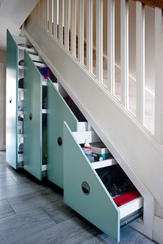 Hallway storage in under stairs space by Avar Furniture