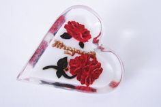 Check out this item in my Etsy shop https://www.etsy.com/listing/218327325/40s-clear-lucite-carved-floral-rose