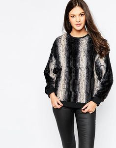 Top by Motel Lightweight faux-fur Super soft-touch finish Crew neckline Oversized sleeves Rbbed trims Regular fit - true to size Hand wash 100% Polyester Our model wears a UK XS/EU XS/US XXS