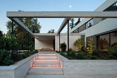 This modern house in Santiago, Chile designed by 57 Studio is surrounded by old growth trees.