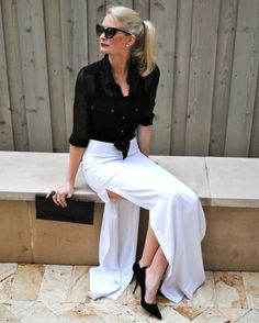 White slit maxi skirt and black sheer blouse complete with cat eye sunglasses, black clutch and pointed pumps. A perfect outfit. Though I'd have to be in Europe to rock this!