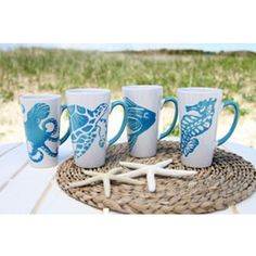 Sea Life Themed Mugs Set of 4 are perfect for your beach home. Ceramic latte mug set includes one of eachsea creature. Octopus,sea turtle,fish,and seahorse. Set of 4 One of each style 17 oz 6 inches Tall Florida Home Decorating, Seaside Home Decor, Nautical Home, Coastal Decor, Beach Cottage Style, Coastal Cottage, Cottage Chic, Design Seeds, Ocean Themes