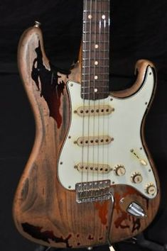 one of the most recognizable guitars, originally played by one of the most revered and underrated guitarists of all time: the late, great Rory Gallagher, and his beloved 1961 Fender Stratocaster.