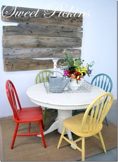 Love the colors of the chairs. Something I have been wanting to do with my own table set
