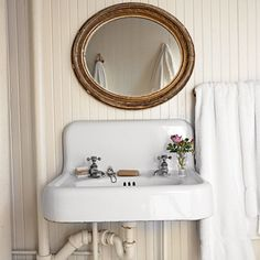 sink-exposed-pipes - How to Decorate with White - Coastal Living