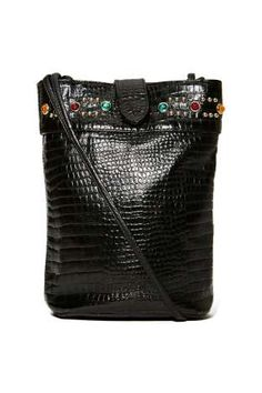 The ultimate throwback purse-- it has a faux snake skin exterior, stud and gem detailing, and interior pocket. Snap closure, fully lined.