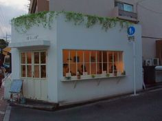 like the ivy hanging over the top. Cafe Shop Design, Store Design, Cafe Display, Mini Cafe, Everything Is Illuminated, Shop Facade, Cafe Concept, Coffee Shop Bar, Architecture Design
