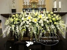Flower arrangements in front of the main altar, using the popular white theme again…we'll be using lilies, roses, snapdragon, hydrangea, baby's breath and orchids!!! I love orchids.