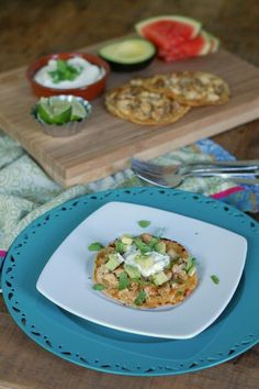 """This dish is super easy to throw together, and it's definitely a crowd pleaser. Who doesn't love Mexican food? I don't think it's a secret that our family is a BIG fan and almost once a week we are sure to enjoy some south of the border fare like homemade refried beans, taco salad, pork carnitas, flank steak fajitas, vegetable quesadillas, homemade tortillas, or the like. And now we can add these """"tostadas"""" to our repertoire..."""