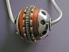 Here is a page of pictures of Mixed Metal Bead Pendants. The bead on the right was silver and copper. Beads are a series of pieces, dom. Metal Clay, Metal Beads, Metal Jewelry, Ethnic Jewelry, Jewellery, Boho Necklace, Necklaces, African Trade Beads, Mixed Metals