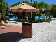 Synthetic wood podium and a single-vent, wooden umbrella will keep your employees organized and cool in the sun. Wood Furniture, Outdoor Furniture, Outdoor Decor, Made In America, Hospitality, Patio, Sun, Cool Stuff, Home Decor