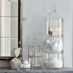 I love apothecary jars in a bathroom. Makes it feel so airy and spa like!